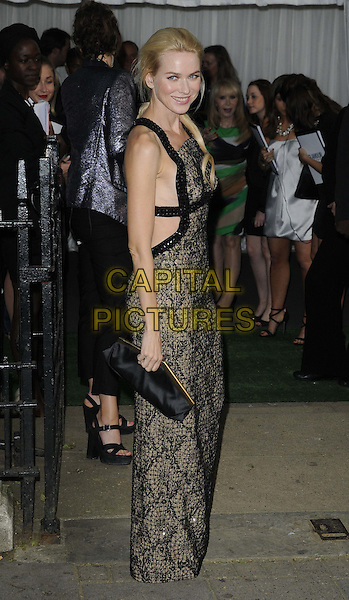 Naomi Watts.The Glamour Women Of The Year Awards 2012, Berkeley Square Gardens, Berkeley Square, London, England..May 29th, 2012.full length black clutch bag beige print dress side snakeskin animal .CAP/CAN.©Can Nguyen/Capital Pictures.