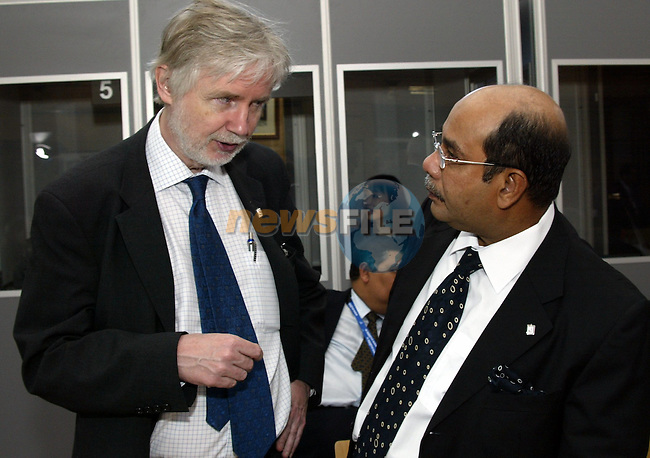 Finnish Erkki Tuomioja Foreign minister,(L) chats with his malaysian contrepart Datuk Syed Hamid Albar prior the 6th ASEM Foreign ministers'meeting in Straffan (Ireland) 18april 2004. AFP PHOTO TONY MAWELL/NEWSFILE