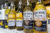 Bottles of imported from Mexico Corona beer are in seen a supermarket in New York on Saturday, April 20, 2013. Anheuser-Busch InBev, maker of Budweiser,  appears ready to buy Grupo Modela, the maker of Corona but will have to sell its stake in distribution of the Mexican beer to Constellation Brands, the other owner. (© Richard B. Levine)