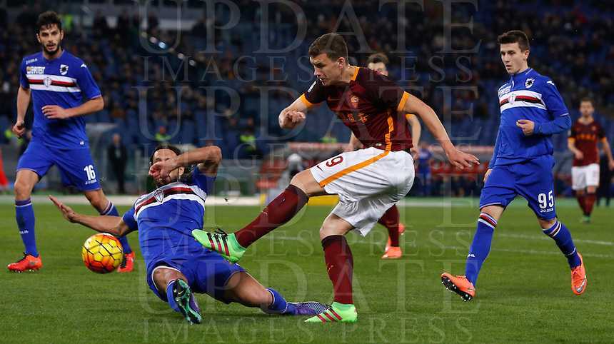 Calcio, Serie A: Roma vs Sampdoria. Roma, stadio Olimpico, 7 febbraio 2016.<br /> Roma&rsquo;s Edin Dzeko, second from right, kicks the ball during the Italian Serie A football match between Roma and Sampdoria at Rome's Olympic stadium, 7 January 2016.<br /> UPDATE IMAGES PRESS/Riccardo De Luca