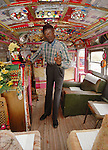 """Reverend Dennis points out the need for prayer to all those who stop by his roadside """"Palace"""" and church. The 90 year old Rev. Dennis has lovingly turned a broken down school bus into a church, and he spreads the gospel to all that stop by to visit him and his wife Miss Margaret at their home on Highway 61 in Vicksburg Mississippi. (Photo/Suzi Altman) Margaret's Grocery Store is now a shrine to Rev. Dennis and Miss Margaret. For over 20 years they welcomed travelers from all over the world to share their beliefs and artistic vision. The Mississippi Folk Art Foundation has been established to help preserve this important folk art creation.To help contact suzisnaps@aol.com"""