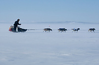 Aaron Burmeister runs into the 35 mph wind on Norton Sound between Shaktoolik and Koyuk during Iditarod 2009