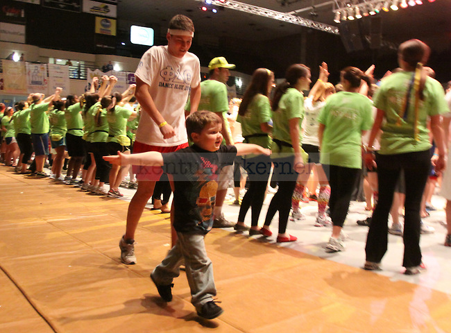 Ashton Lovett runs in front of dancers with freshman civil engineering major Daniel Rhollans during Dance Blue 2011, a 24-hour dance marathon to raise money and awareness for child cancer. Photo by Scott Hannigan | Staff