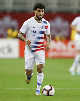 TORONTO, ON - OCTOBER 15: DeAndre Yedlin #2 of the United States dribbles with the ball during a game between Canada and USMNT at BMO Field on October 15, 2019 in Toronto, Canada.