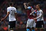 Christian Benteke of Aston Villa vents anger at Tottenham's Etienne Capoue following a challenge - Aston Villa vs. Tottenham Hotspurs - Barclay's Premier League - Villa Park - Birmingham - 02/11/2014 Pic Philip Oldham/Sportimage