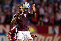 Colorado Rapids forward Caleb Folan (21) with both eyes on the ball. The Colorado Rapids defeated CD Chivas USA 1-0 at Home Depot Center stadium in Carson, California on Saturday March 26, 2011...