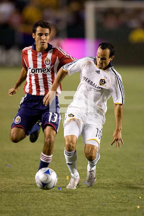 LA Galaxy forward Landon Donovan (10) dribbles past Chivas USA defender Jonathan Bornstein (13) on his way scoring one of his three goals during the Super Clasico MLS match. The LA Galaxy defeated Chivas USA 5-2 during the SuperClasico at the Home Depot Center Stadium, in Carson, California, Saturday, April 26, 2008.