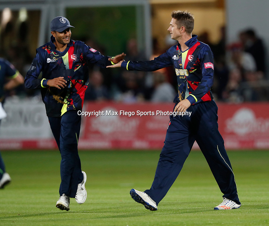 Joe Denly is congratulated by Imran Qayyum after taking the wicket of Peter Trego during the Vitality Blast T20 game between Kent Spitfires and Somerset at the St Lawrence Ground, Canterbury, on Thur Aug 16, 2018