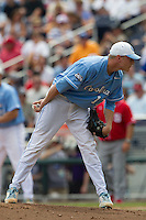 North Carolina pitcher Chris McCue (17) looks to his catcher for the sign during Game 3 of the 2013 Men's College World Series against the North Carolina State Wolfpack at TD Ameritrade Park on June 16, 2013 in Omaha, Nebraska. The Wolfpack defeated the Tar Heels 8-1. (Andrew Woolley/Four Seam Images)