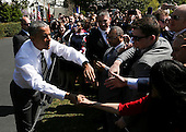 United States President Barack Obama shakes hands with the public at the end of the Wounded Warrior Ride at the White House, in Washington, DC, April 14, 2016.  The event helps raise awareness to the public about severely injured veterans and provides rehabilitation opportunities. <br /> Credit: Aude Guerrucci / Pool via CNP