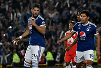BOGOTÁ - COLOMBIA, 15-01-2019: Matías de los Santos (Izq.), jugador de Millonarios, celebra con Roberto Ovelar (Der.) el gol anotado a Independiente Santa Fe, durante partido entre Independiente Santa Fe y Millonarios, por el Torneo Fox Sports 2019, jugado en el estadio Nemesio Camacho El Campin de la ciudad de Bogotá.  / Matías de los Santos (L), player of Millonarios, celebrates with Roberto Ovelar (R) a goal scoring to Independiente Santa Fe, during a match between Independiente Santa Fe and Millonarios, for the Fox Sports Tournament 2019, played at the Nemesio Camacho El Campin stadium in the city of Bogota. Photo: VizzorImage / Luis Ramírez / Staff.