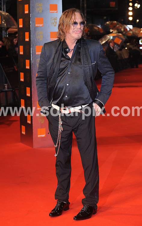 **ALL ROUND PICTURES FROM SOLARPIX.COM**.**WORLDWIDE SYNDICATION RIGHTS**.arrivals for the 2009 Orange British Academy Film Awards, the BAFTAs, held at the Royal Opera House, London, UK. 8 February 2009..This pic: Mickey Rourke..JOB REF:  8422 SSD     DATE: 08_02_2009.**MUST CREDIT SOLARPIX.COM OR DOUBLE FEE WILL BE CHARGED**.**ONLINE USAGE FEE  GBP 50.00 PER PICTURE - NOTIFICATION OF USAGE TO PHOTO @ SOLARPIX.COM**