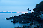 Lime Kiln Point State Park at night with light glowing in the lighthouse