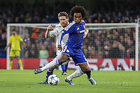 Willian of Chelsea holds up the ball under pressure from Antunes of Dynamo Kyiv during the UEFA Champions League Group match between Chelsea and Dynamo Kyiv at Stamford Bridge, London, England on 4 November 2015. Photo by David Horn.