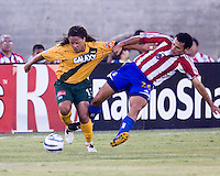 The LA Galaxy's Cobi Jones battles against Chivas USA's Jesus Ochoa at the LA Memorial Coliseum in LA, Calif., Wednesday August 11, 2005.  (Photo by Brooks Parkenridge/ISI)