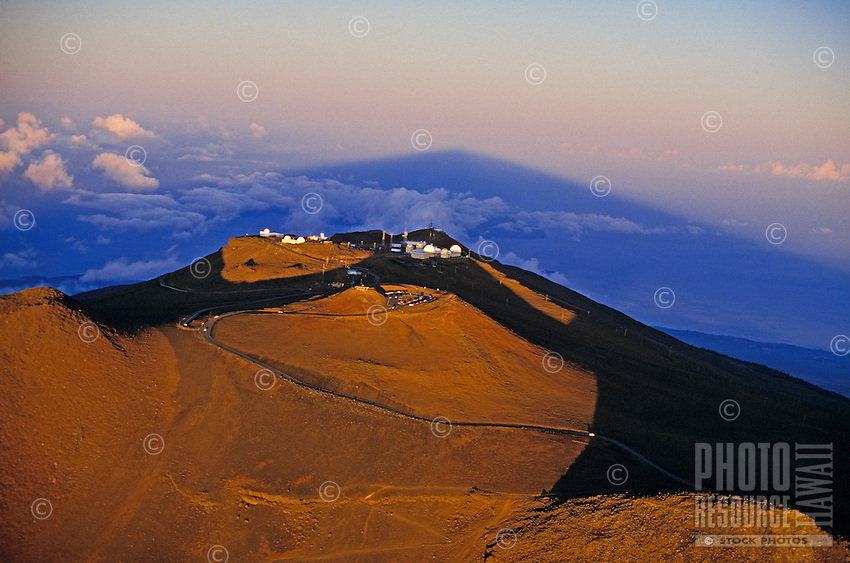 Aerial of Haleakala Crater with observatories at sunrise.