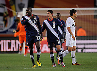 Jozy Altidore (17) of USA shows his frustration as he is held back by Herculez Gomez (9). USA tied Slovenia 2-2 in the 2010 FIFA World Cup at Ellis Park in Johannesburg, South Africa on June 18th, 2010.