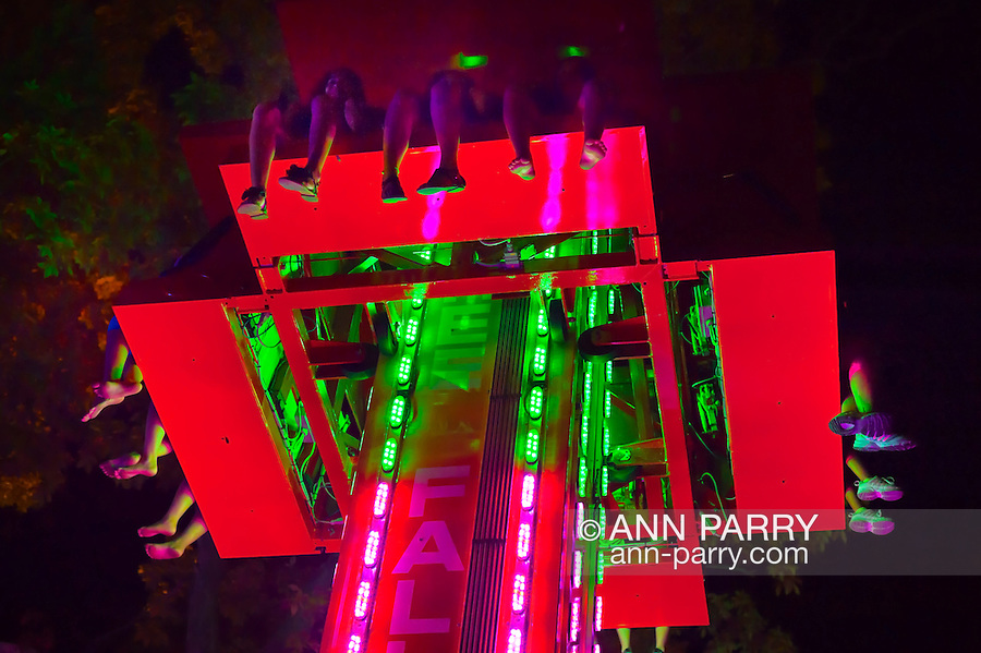 Aug. 25, 2012 - Middlebury, Connecticut, U.S.- Looking up at the Free Fall 'N Drop Tower, one sees feet dangling high in the air as people ride the colorfully iighted ride during night, at Quassy Amusement Park.