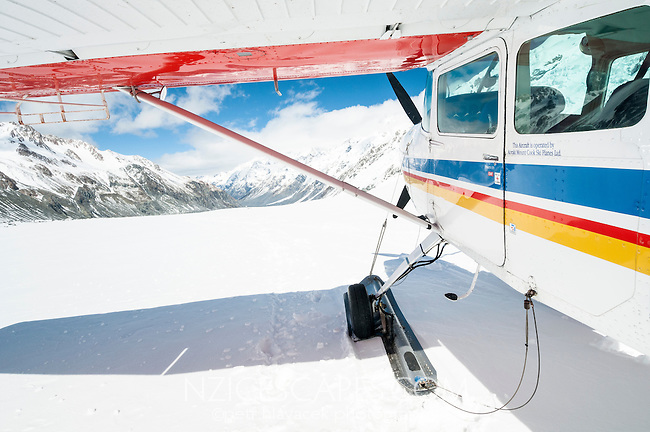 Ski plane in pristine upper parts of Tasman Glacier, Aoraki Mt. Cook National Park, Mackenzie Country, South Island, New Zealand