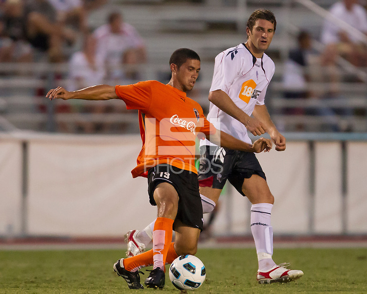 Miguel Ferrer of the Charlotte Eagles dribbles with the ball against the Bolton Wanderers.  The Charlotte Eagles currently in 3rd place in the USL second division played a friendly against the Bolton Wanderers from the English Premier League losing 3-0.