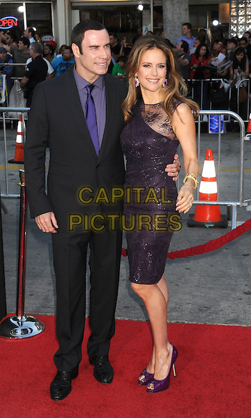 "John Travolta, Kelly Preston.arriving at the Los Angeles premiere of ""Savages"" at Mann Village Theatre in Westwood, California, USA, .June 25th, 2012..full length black grey gray suit dress  smiling purple shirt tie lace sparkly peep toe shoes couple married husband wife .CAP/ROT/TM.©TM/Roth Stock/Capital Pictures"
