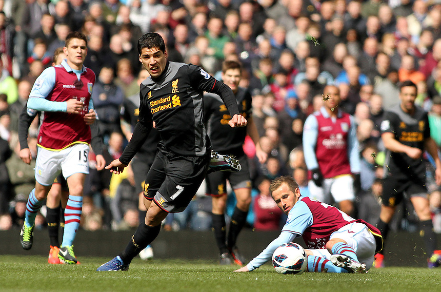Liverpool's Luis Suarez attacks on a lose ball from Aston Villa's Barry Bannan. .- Credit - CameraSport - James Marsh - ..Football - Barclays Premiership - Aston Villa v Liverpool - Sunday 31st March 2013 - Villa Park - Birmingham ..© CameraSport - 43 Linden Ave. Countesthorpe. Leicester. England. LE8 5PG - Tel: +44 (0) 116 277 4147 - admin@camerasport.com - www.camerasport.com