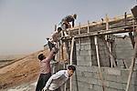 06/06/14. Goktapa, Iraq. Jasm at work building a house.
