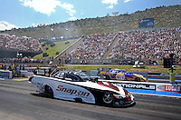 Jul. 21, 2013; Morrison, CO, USA: NHRA funny car driver Cruz Pedregon (near) races alongside Ron Capps during the Mile High Nationals at Bandimere Speedway. Mandatory Credit: Mark J. Rebilas-