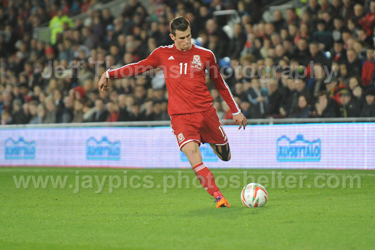Gareth Bale of Wales taking a free kick during the Wales v Finland Vauxhall International friendly football match at the Cardiff City stadium, Cardiff, Wales. Photographer - Jeff Thomas Photography. Mob 07837 386244. All use of pictures are chargeable.