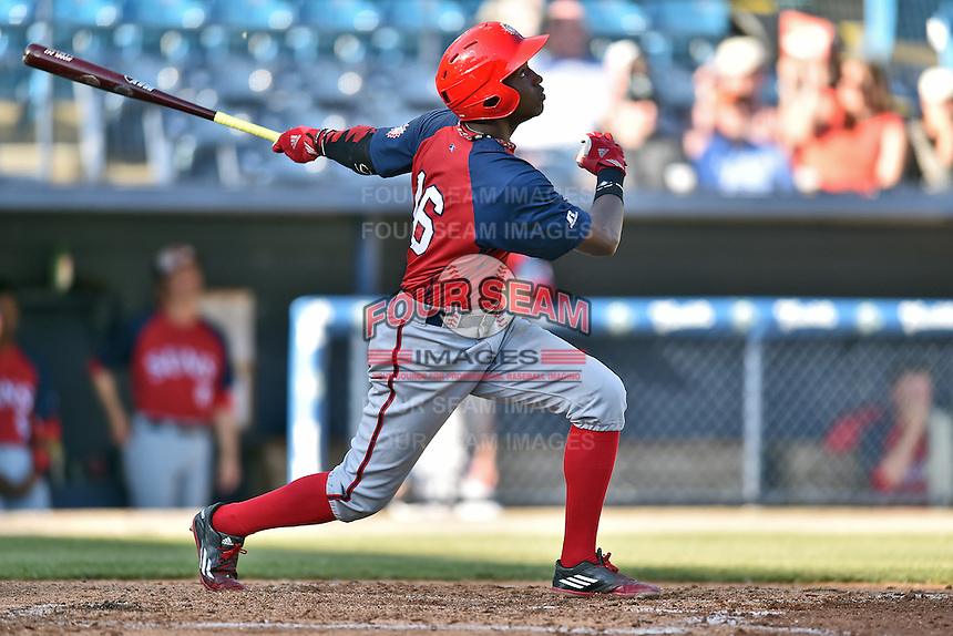 Hagerstown Suns center fielder Victor Robles (16) swings at a pitch during a game against the Asheville Tourists at McCormick Field on April 28, 2016 in Asheville, North Carolina. The Tourists were leading the Suns 6-5 when the game was delayed in the top of the 6th inning due to darkness. (Tony Farlow/Four Seam Images)