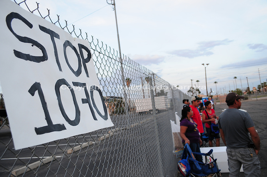 "Phoenix, Arizona. September 22, 2012 - A ""Stop SB 1070"" poster hanged on a fence of the lot where the ""Festival of Resistance"" was held, seeks to inspire undocumented immigrants to show resistance to SB 1070, Arizona's ""Show Me Your Papers,"" law. Photo by Eduardo Barraza © 2012"