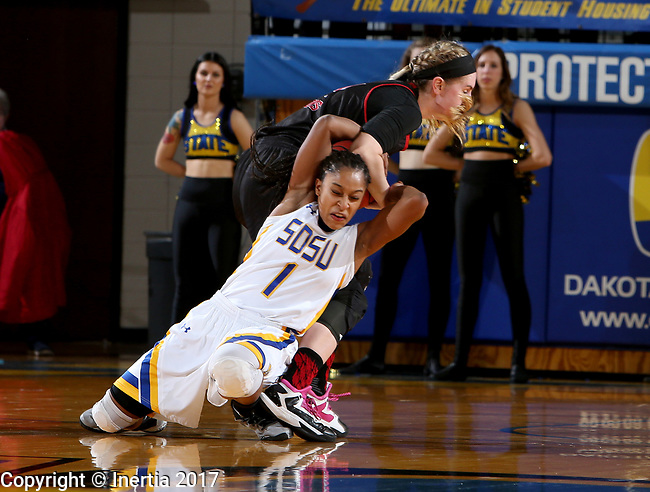 BROOKINGS, SD - MARCH 16:  Alexis Alexander #1 from South Dakota State University ties up the ball with Kelly Smith #25 from Northern Illinois during their first round WNIT game Thursday at Frost Arena in Brookings.(Photo by Dave Eggen/Inertia)