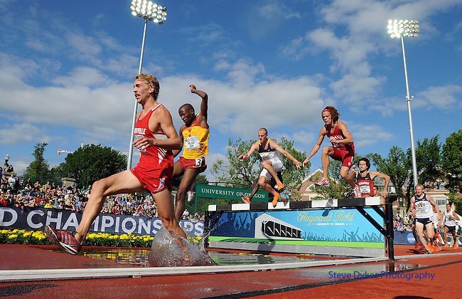 11 JUNE 2010: Matt Hughes of Louisville leads the runners through the water jump on his way to winning the Mens 3000 meter Steeplechase during the Division I Men's and Women's Track and Field Championship held at Hayward Field on the University of Oregon campus in Eugene, OR.  Steve Dykes/NCAA Photos