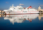 Juan J Sister Acciona Trasmediterranea shipping line Ro-Ro ferry ship moored in the port at Malaga, Spain