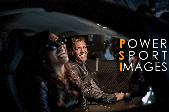 Formula One double World Champion Sebastian Vettel of Germany stars in the official music video for US R&B singer Melanie Fiona's track 'Watch Me Work' in New York on June 11, 2012, USA. The project is the latest in the Infiniti 'Inspired Performers' Series which shows the Red Bull Racing F1 drivers collaborating with other top performers. The video features Vettel driving Fiona in an Infiniti G37 Convertible. Photo by Victor Fraile / The Power of Sport Images for Infiniti