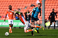 Fleetwood Town's Kyle Dempsey fouls Blackpool's Oliver Turton<br /> <br /> Photographer Richard Martin-Roberts/CameraSport<br /> <br /> The EFL Sky Bet League One - Blackpool v Fleetwood Town - Saturday 14th April 2018 - Bloomfield Road - Blackpool<br /> <br /> World Copyright &not;&copy; 2018 CameraSport. All rights reserved. 43 Linden Ave. Countesthorpe. Leicester. England. LE8 5PG - Tel: +44 (0) 116 277 4147 - admin@camerasport.com - www.camerasport.com