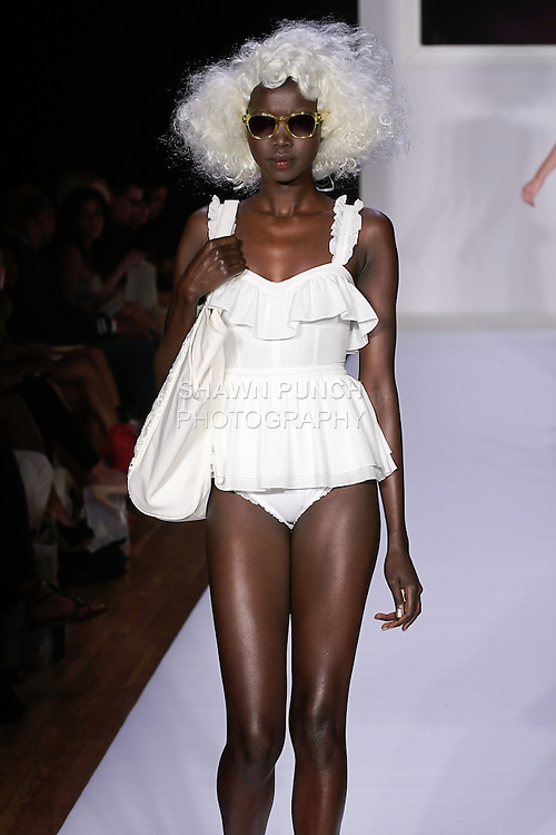 Nykhor walks runway in an ecru silk & cotton voile pinafore body suit, Natural canvas and antique lace tote, and Sarah natural lace oxford, for the bebe BLACK Spring 2012 collection fashon show, during Elle Stlye 360 Spring 2012 Fashion Week.