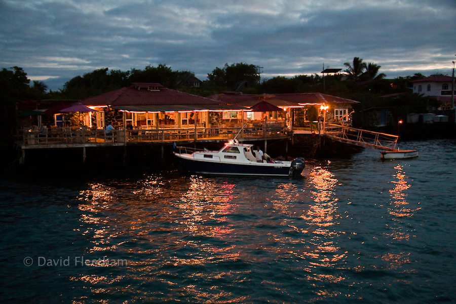 A boat pulls up to the Angermeyer Point Restaurant in Puerto Ayora, Santa Cruz Island, Galapagos Archipelago, Ecuador.
