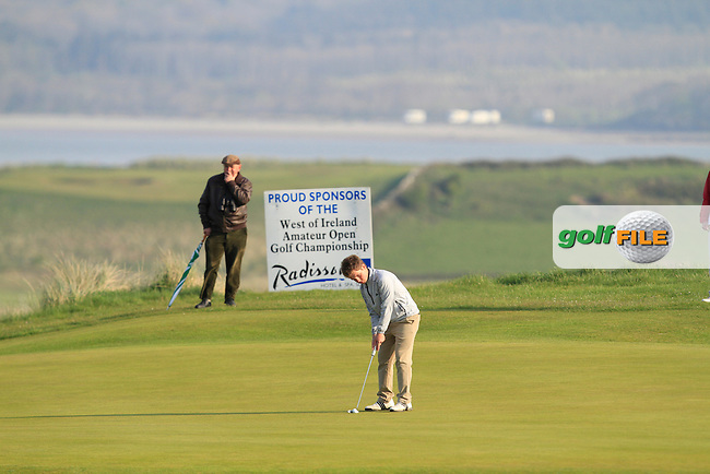 Jack Hume (Naas) on the 4th green during the Semi-Finals of The West of Ireland Amateur Open in Co. Sligo Golf Club on Tuesday 22nd April 2014.<br /> Picture:  Thos Caffrey / www.golffile.ie