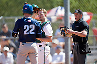 Dartmouth Big Green catcher Kyle Holbrook (9) looks on as Timothy Lilly (22) talks with the home plate umpire during a game against the Villanova Wildcats on March 3, 2018 at North Charlotte Regional Park in Port Charlotte, Florida.  Dartmouth defeated Villanova 12-7.  (Mike Janes/Four Seam Images)