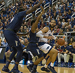 Nevada forward Cody Martin, right, draws a double team defense against Akron in the first half of an NCAA college basketball game in Reno, Nev., Saturday, Dec. 22, 2018. (AP Photo/Tom R. Smedes)