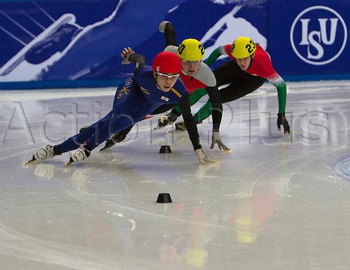 12.03.2011 ISU World Short Track Speed Skating Championships from Sheffield. Mens 500 mts heats showing - (Red Hat) Noh, Jinkyu (Kor), 260 Kulesza, Dariusz (Pol) and 238 Olah, Bence (Hun)