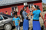 ROMa people outside the Pentecostal church in South Romania, Barbulesti. 15 years ago the population of Barbulesti, a village inhabited mostly by Roma people sittuated in the south of Romania, started to convert to the Pentecostal Church. Belivers say that conversion led to a decrease in crime in the area, although official statistics do not confirm it.