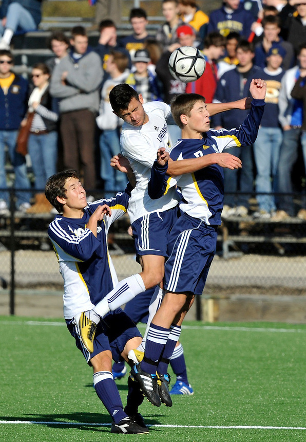Heading the ball are Marquette High School's Logan Andryk (right) and Appleton North's Elias Ethmimiou (center) during the state final soccer game at Uilhlein Field on Saturday, Oct. 30, 2010. At left is Marquette's Joey Grandelis. Ernie Mastroianni photo.