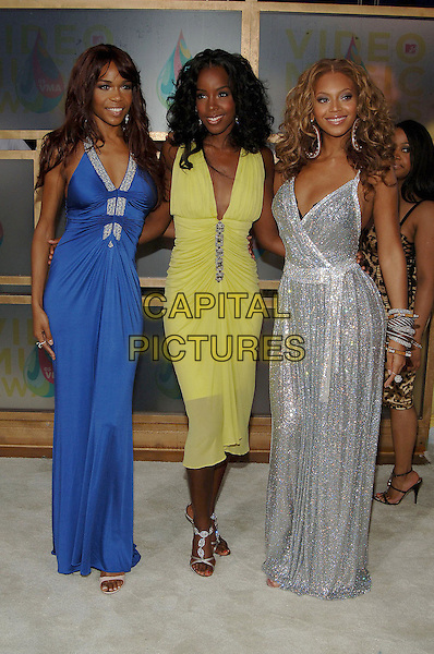 MICHELLE WILLIAMS, KELLY ROWLAND & BEYONCE KNOWLES (DESTINY'S CHILD).MTV Video Music Awards.Arrivals held at the American Airlines Arena,.Miami, 28th August 2005.full length blue lime green yellow silver dress bangles.Ref: ADM/JW.www.capitalpictures.com.sales@capitalpictures.com.© Capital Pictures.v-neck plunging neckline