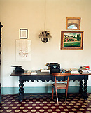 ITALY, Siena, interior of office room with printer and books on table at Castello Di Spannochia.
