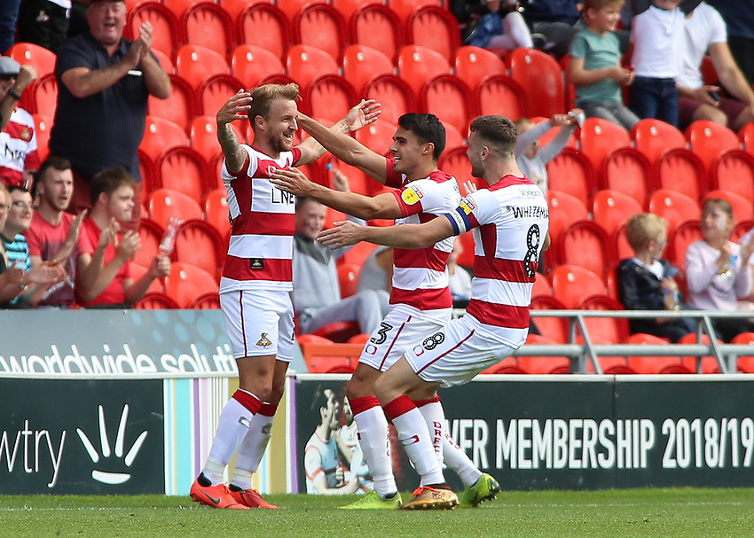 Doncaster Rovers' James Coppinger (left) celebrates after putting his side 2-1 ahead<br /> <br /> Photographer David Shipman/CameraSport<br /> <br /> The EFL Sky Bet League One - Doncaster Rovers v Fleetwood Town - Saturday 17th August 2019  - Keepmoat Stadium - Doncaster<br /> <br /> World Copyright © 2019 CameraSport. All rights reserved. 43 Linden Ave. Countesthorpe. Leicester. England. LE8 5PG - Tel: +44 (0) 116 277 4147 - admin@camerasport.com - www.camerasport.com