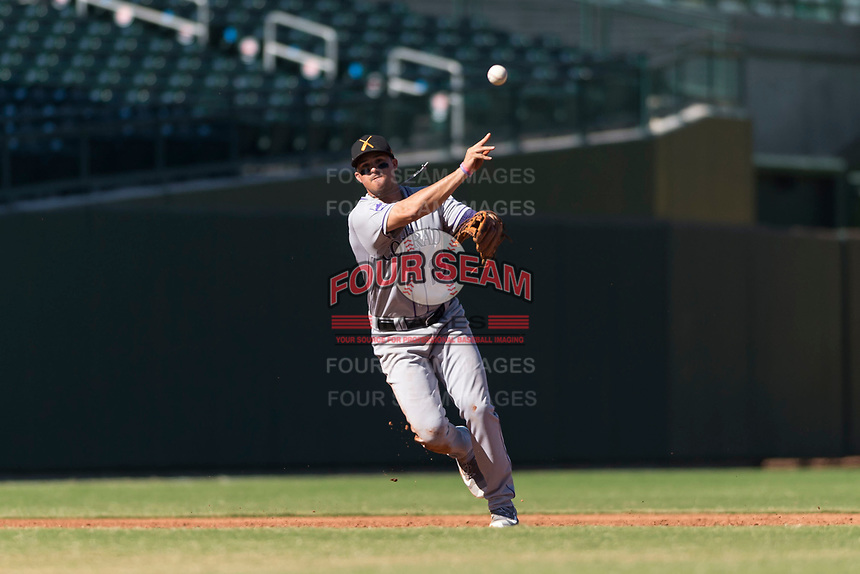 Salt River Rafters third baseman Josh Fuentes (19), of the Colorado Rockies organization, throws to first base during an Arizona Fall League game against the Mesa Solar Sox at Sloan Park on October 30, 2018 in Mesa, Arizona. Salt River defeated Mesa 14-4 . (Zachary Lucy/Four Seam Images)