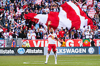 Thierry Henry (14) of the New York Red Bulls celebrates scoring the game winning goal. The New York Red Bulls defeated the Philadelphia Union 2-1 during a Major League Soccer (MLS) match at Red Bull Arena in Harrison, NJ, on March 30, 2013.