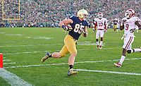 Tight end Troy Niklas (85) catches a Tommy Rees pass and runs into the end zone for ND's third and final touchdown.
